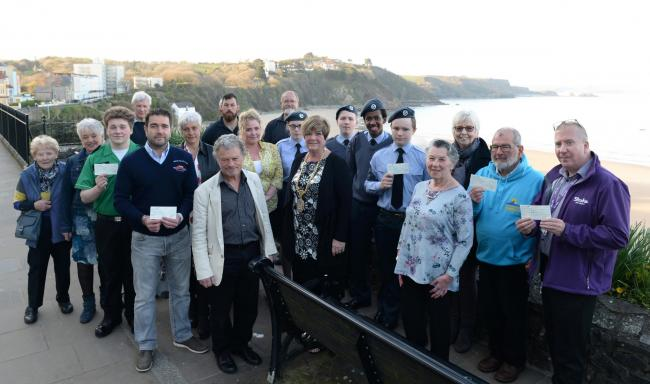Tenby's mayor, Councillor Sue Lane is pictured after the Tenby Boxing Day Swim presentation with charity recipients and committee members. PICTURE: Gareth Davies Photography