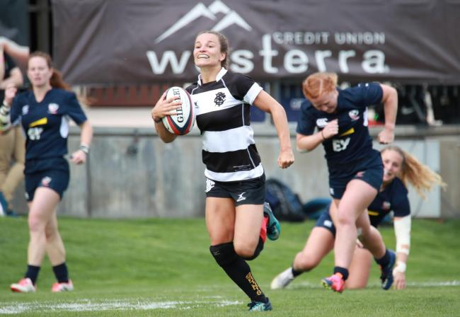 Jasmine Joyce on the way to one of her four tries.
