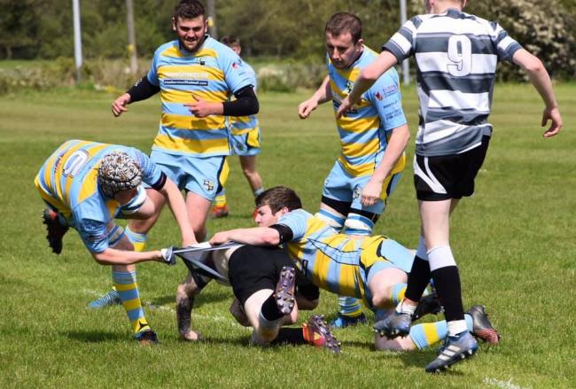 Owain Thomas makes a tackle for Laugharne. PICTURE:  Kelly Sophie Pearce.