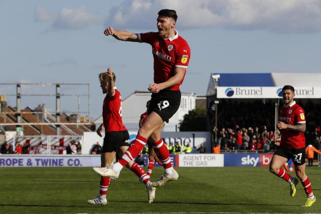 Barnsley striker Kieffer Moore has been called up for Wales' training camp in Portugal