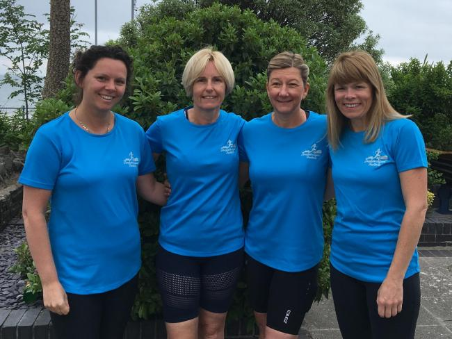Ashmole & Co staff with Bryan's wife Mandy, who are taking part in the Swansea Half Marathon. From left: Mandy Jones (Bryan's wife) from the Haverfordwest office and Bryan and Mandy's friends - Victoria Randall, Rachel Treadway-Willi
